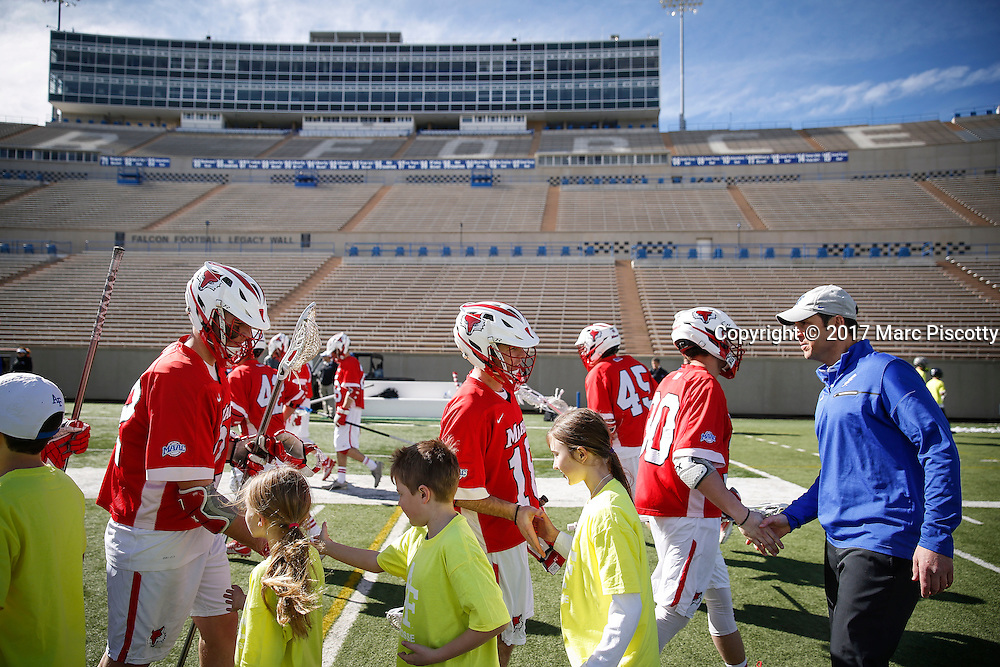 SHOT 2/18/17 2:42:45 PM - Air Force head lacrosse coach Eric Seremet shakes hands with the opposing team after losing to Marist College at Falcon Stadium at the Air Force Academy in Colorado Springs, Co. Marist won the game 10-4. Seremet is in his ninth season as the head coach for the Air Force lacrosse program.<br /> (Photo by Marc Piscotty / &copy; 2017)