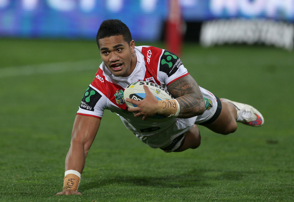 Peter Mata`utia of the Dragons scores a try against the Warriors during their round 22 NRL match at Westpac  Stadium, Wellington on  Saturday, August 08, 2015. Credit: SNPA / David Rowland