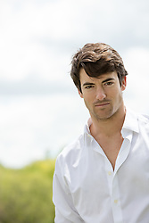 portrait of a sexy man in a white button down shirt