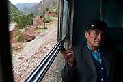 Juan Lazaro, the train fare inspector, takes a break in between stations.