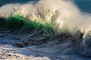 Backlit wave breaking off of Oahu, Hawaii