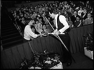 "The Benson and Hedges .Irish Masters Snooker..1984..28.03.1984..03.28.1984..28th March 1984..The championship was held at Goffs,Co Kildare. All the top names in snooker took part..Steve Davis,Jimmy White,Eddie Charlton,.Tony Knowles,Dennis Taylor,Tony Meo,.Alex Higgins,Ray Reardon,.Cliff Thorburn,Terry Griffiths,.Bill Werbeniuk and Eugene Hughes..The eventual winner was Steve Davis who beat Terry Griffiths 9 -1 in the final..In the second match of the night, fans favourite, Alex ""Hurricane' Higgins signs an autograph for a fan."