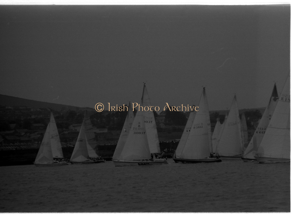 Round Ireland Yacht Race.  (R81)..1988..18.06.1988..06.18.1988..18th June 1988..The Round Ireland Yacht Race set sail from Wicklow today. Yachts from all over Europe took part in the start as the race got underway. The race is sponsored by Cork Dry Gin...Image shows the yachts lining up for the start of the race.