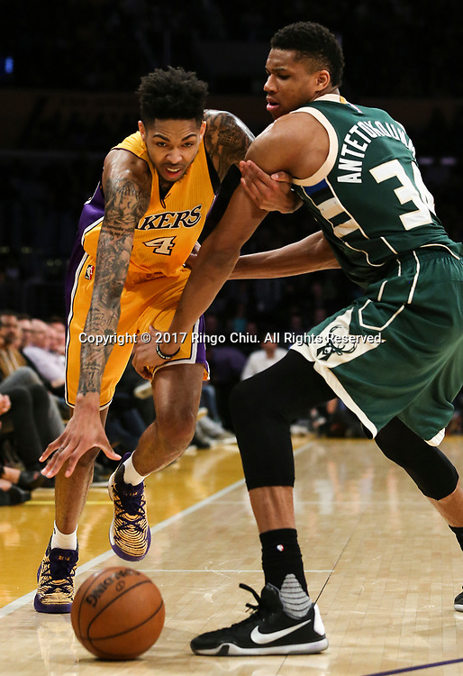 Los Angeles Lakers forward Brandon Ingram (#14) dribbles against Milwaukee Bucks during an NBA basketball game, Friday, March 17, 2017.(Photo by Ringo Chiu/PHOTOFORMULA.com)<br /> <br /> Usage Notes: This content is intended for editorial use only. For other uses, additional clearances may be required.