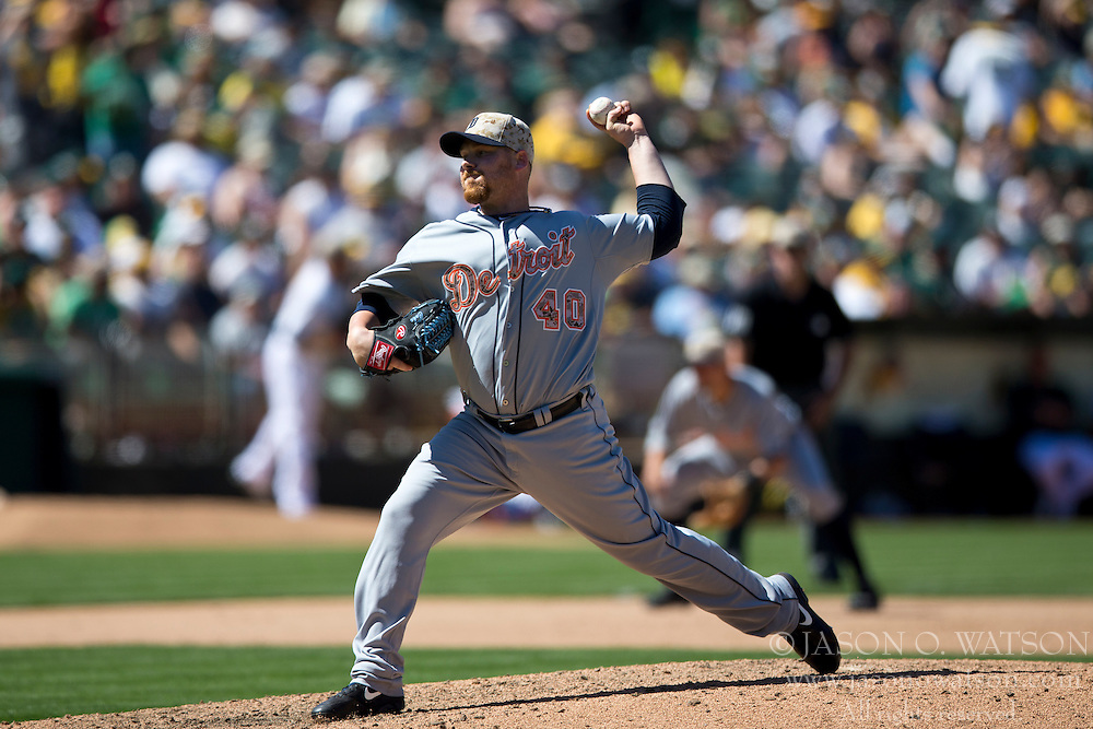 OAKLAND, CA - MAY 26:  Phil Coke #40 of the Detroit Tigers pitches against the Oakland Athletics during the eighth inning at O.co Coliseum on May 26, 2014 in Oakland, California. The Oakland Athletics defeated the Detroit Tigers 10-0.  (Photo by Jason O. Watson/Getty Images) *** Local Caption *** Phil Coke