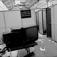 'GovanHell', portrait of a community. Demonstrators illegally enter the Allison Street swimming pool which had been closed by the council, against the desires or wishes of the local community who then protested, Govanhill, Glasgow, Scotland, UK. (Approx Date 2001)
