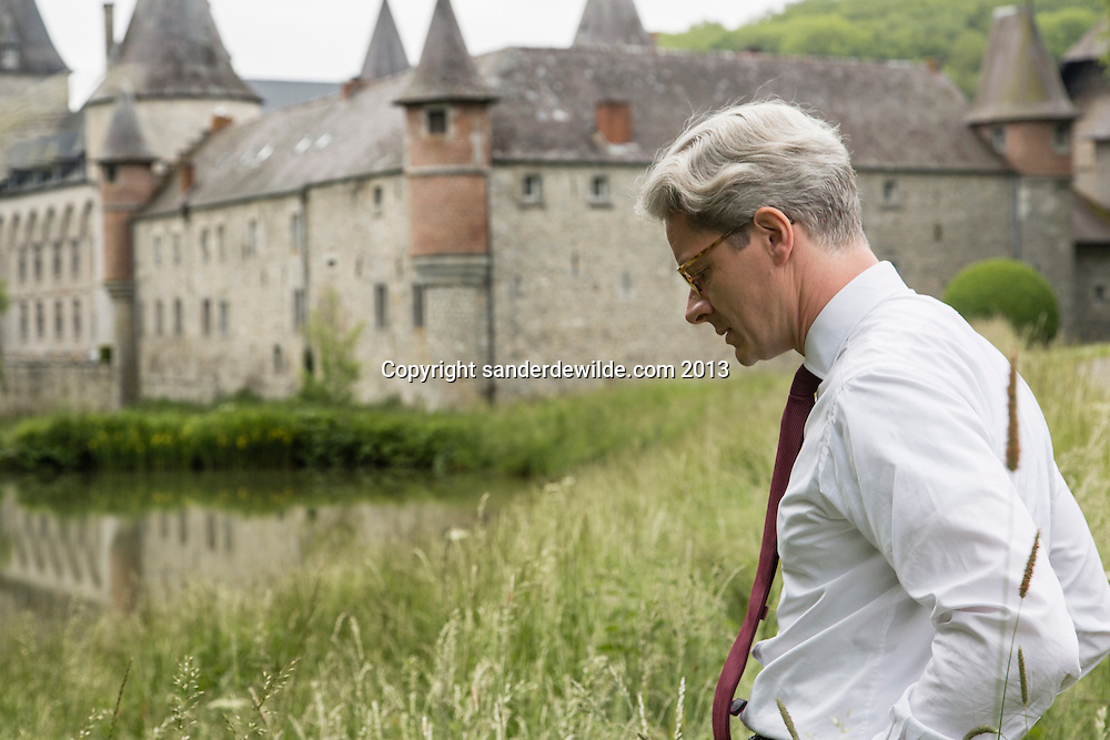 Interior architectThierry THENAERS walks in front of  the Chateau d'Anthée, part of which has been renovated and decorated by him in Anthée, Belgium on the 10th of June 2013, Anthée, Belgium. Credit Sander de Wilde for The Wall Street Journal.  Castle