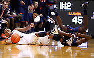 WEST LAFAYETTE, IN - JANUARY 02: Terone Johnson #0 of the Purdue Boilermakers and Nnanna Egwu #32 of the Illinois Fighting Illini scramble for a loose ball at Mackey Arena on January 2, 2013 in West Lafayette, Indiana. Purdue defeated Illinois 68-61. (Photo by Michael Hickey/Getty Images) *** Local Caption *** Terone Johnson; Nnanna Egwu