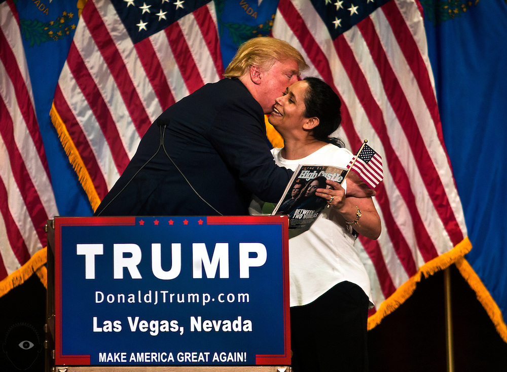 Republican Presidential candidate Donald Trump kisses supporter Myriam Witcher on stage with him during a speech in Mystere at Treasure Island during another campaign stop in Las Vegas on Thursday, October 08, 2015.