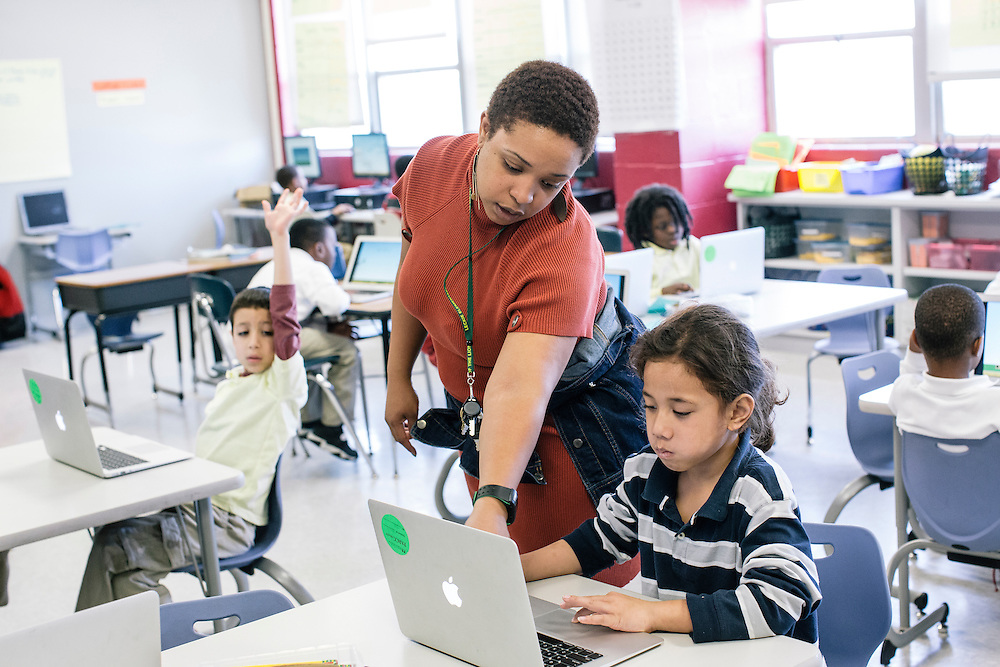 Kristee Jones, a first-grade math teacher, works with students including children like Ioasa Lauofo, 7, who have parents in the military, at Leckie Elementary School in SW Washington, D.C. Nearly a third of the school is attended by the children of military families.
