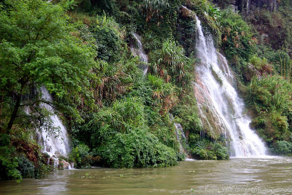 Asia, China, Guangxi, Guilin, Li River. Waterfalls dot the misty scenery of the Li JIang river cruise.