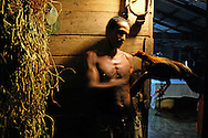 Man with chicken near La Maquina, Guantanamo, Guantanamo, Cuba.