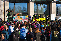 London, March 7th 2015. Following the Climate march through London, masked anarchists and environmental activists clash with police following a breakaway protest at Shell House. PICTURED: Protesters demonstrate outside Shell House.