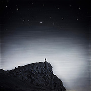 Surreal landscape with a figure on a rock - manipulated photograph<br /> Redbubble products: http://www.redbubble.com/people/dyrkwyst/works/19188058-existence?ref=recent-owner
