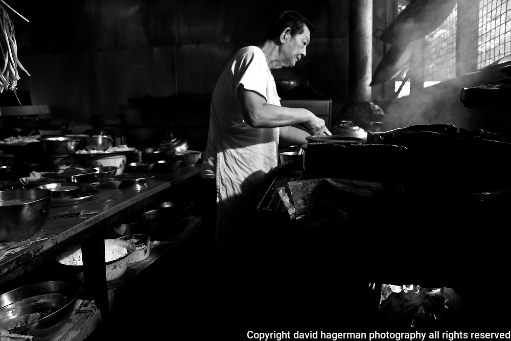 Cooking in a traditional chinese restaurant kitchen, Kuala Lumpur, Malaysia