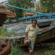 To mitigate the financial loss, the fisherman Eduardo Barcelos conducts expeditions along the Rio Doce with scientists and journalists
