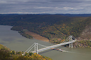 Bear Mountain, New York  - A tugboat pushes barges north on the Hudson River by the Bear Mountain Bridge on Oct. 24, 2014. ©Tom Bushey / The Image Works