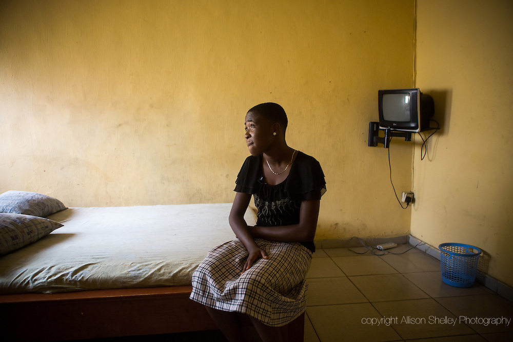 A girl, 16, who preferred not to be named, sits on the bed in a hotel where her best friend was raped a year before by a guy she met on a social networking website, in Lagos, Nigeria, September 3, 2013.  She had accompanied the friend to the hotel, where they were expecting a casual meet-up, until the man locked her out of the room.  The friend died of complications from a botched abortion resulting from the rape about two months afterwards. In Nigeria, abortion is only officially legal to save the life of the mother.  But stigmatization drives the practice deeply underground, making it extremely risky for the majority, who cannot afford to visit a trained doctor.