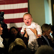 Hillary Clinton holds a baby after her Organizing for Change event at the Chicken Inn during her campaign for the 2008 Democratic presidential nomination, Creston, Iowa, November 20, 2007.