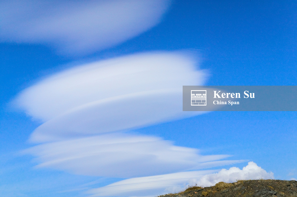 Dramatic clouds in the blue sky over meadow, Torres del Paine National Park, Patagonia, Chile