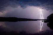 Lightning flashes over the marshes of the May River's headwaters on a hot summer night near Bluffton, S.C.