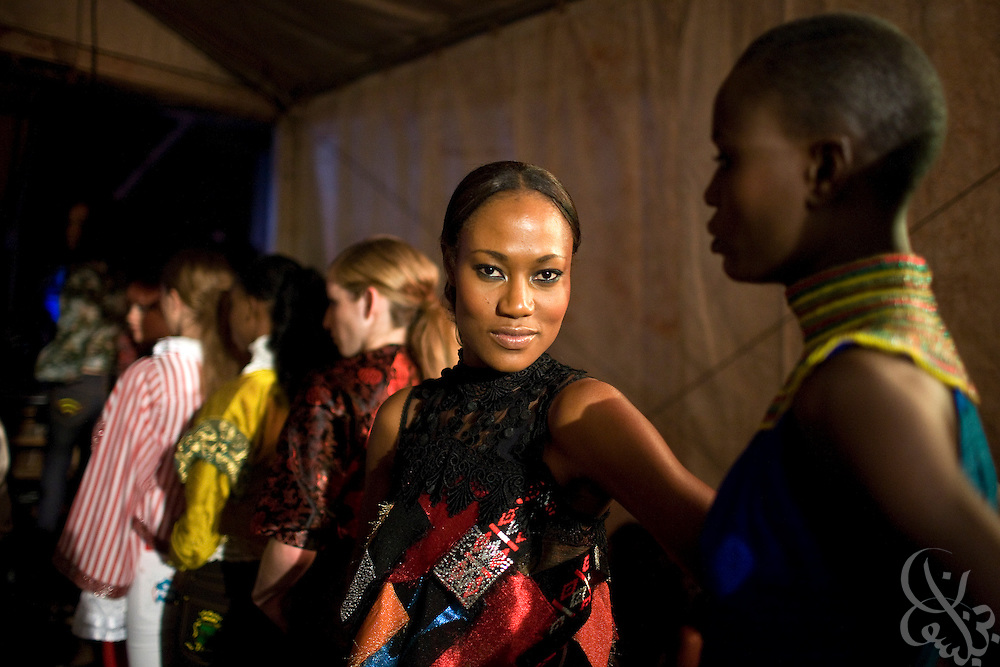 """Nigerian and International models prepare backstage for a show by African fashion designer Deola Sagoe during the July 13, 2008 leg of the ThisDay music and fashion festival in Lagos, Nigeria. The festival, themed """"Africa Rising"""", aims to raise awareness of African issues while promoting positive images of Africa using music, fashion and culture in a series of concerts and events in Nigeria, the United States and the United Kingdom. ."""
