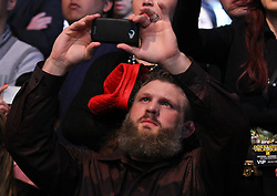 Las Vegas, NV - December 29, 2012: UFC Heavyweight Roy Nelson takes an iPhone shot of the Junior Dos Santos-Cain Velasquez bout at UFC 155 at MGM Grand Garden Arena in Las Vegas, Nevada.