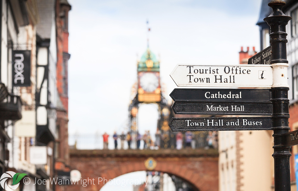 Signs to key destinations and attractions in Chester city centre, with the iconic Eastgate Clock in the background.