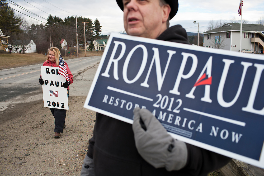 Susan Gayhart, left, and Mark Whitty hold signs for Republican presidential candidate Ron Paul on Tuesday, January 10, 2012 in Canaan, NH. Brendan Hoffman for the New York Times