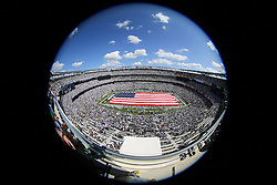 EAST RUTHERFORD, NJ - SEPTEMBER 7: A giant American flag is unveiled on the field before the game between the Oakland Raiders and the New York Jets at MetLife Stadium on September 7, 2012 in East Rutherford, NJ.  (Photo by Ed Mulholland/Getty Images)