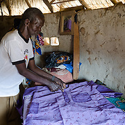 Rakisba Ouedraogo, Rihanata Ouedraogo's father, is a tailor. He is seen in his workshop at the family home on 27 February 2014.