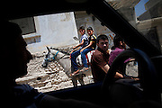 Two teenage boys rides on a horse through the streets of Koreen passing motorbikes and cars.<br />