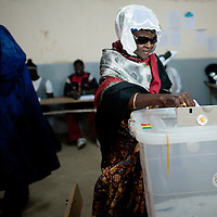 Senegalese elector votes in the presidential elections at a polling station in a Franco-Arab School in Point E area of Dakar..Hundreds of people, queueing for voting since the early hours, insulted and heckled the president and candidate Abdoulaye Wade during his vote casting at the poll station, accusing the head of state of disrespect for the country's constitution when running for a third term in office..Tensions between opposition supporters and security forces have been high in the capital Dakar and other cities around the country since Wade announce his candidature late July. Some violent clashes culminated with the death of 12 people and many injured in the past month alone. ©Sylvain Cherkaoui
