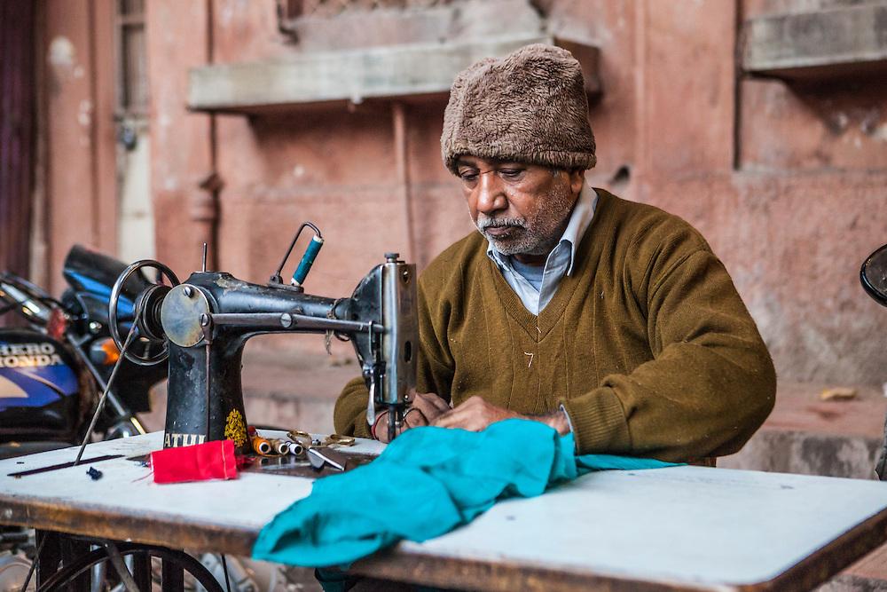 A man working at a sewing machine in Sadar Market in Jodhpur, Rajasthan, India.