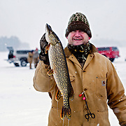 Showing off a Northern Pike caught during an ice fishing tournament in Northern Wisconsin. ..