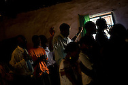 Residents worship in a church in the Kibera slum of Nairobi, Kenya June , 2008.Kibera is home to nearly 1million people living in an area roughly the size of New York's Central Park with sprawling market places and  PHOTO BY KEITH BEDFORD