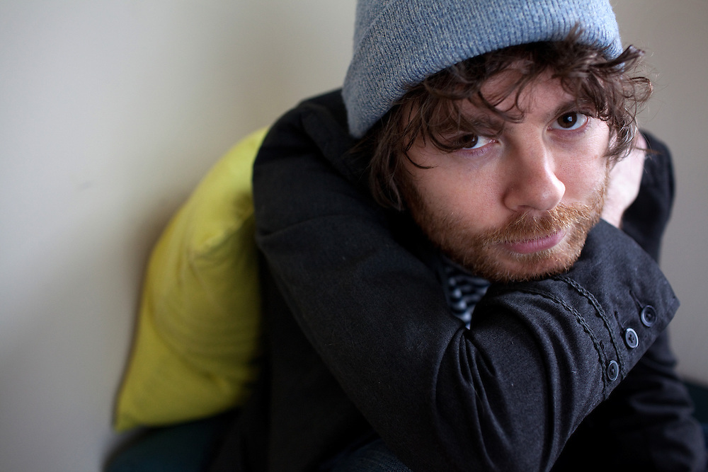 NEW YORK, NY - MARCH 25: Composer, songwriter and performer Gabriel Kahane at his home in Brooklyn, NY on March 25, 2013. .Kahane is a 31-year-old composer of the 'indie-classical' genre who has two performances coming up in Washington D.C., one sponsored by the Library of Congress in which he appears in recital with another composer/performer, and one with the Orpheus Chamber Orchestra; he's their first composer in residence and has written a new work that's a portrait of the USA based on WPA travel guides from the 1930s. Last year his musical FEBRUARY HOUSE got rave reviews for its run at the Public Theater in NY.