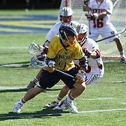 Drexel Midfielder Ben McIntosh (9), CENTER, position himself towards the goal as Denver Attacker Tyler Simmons (38) defends in the second half of The NCAA Division I Men's Lacrosse Tournament game between the No. 5 seed Denver and No. 12 ranked Drexel Sunday, May. 18, 2014 at Delaware Stadium in Newark, DEL