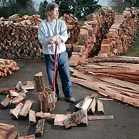PE00126-00...WASHINGTON - Splitting firewood. (MR #K1)