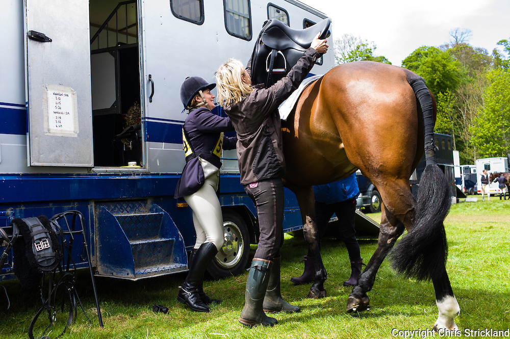 Floors Castle, Kelso, Roxburghshire, UK. 16th May 2015. Kelso eventer Kirsty Brewis gets ready for dressage with 'Marcus' at the Floors Castle International Horse Trials in the parkland of Roxburghe Estate in the Scottish Borders.