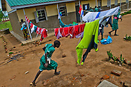 Student races to class at the Olikwi primary school in Nimule city in Sudan.