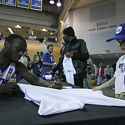 Delaware 87ers Guard isa (12) signs a autograph for a young fan following a 115-88 NBA D-league regular season lost to the Idaho Stampede Thursday, Dec. 12, 2013 at The Bob Carpenter Sports Convocation Center, Newark, DE