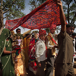 Bridegrooms Hariprasad, 22, and Kishore, 13, lead their new wives Sarita, 15, and Maya, 8, to their new homes the day after the Hindu holy day of Akshaya Tritiya, or Akha Teej, in Rajasthan, India on April 29, 2009.