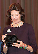 KERKRADE - Swedish Queen Silvia receives the Martin Buber Plaque from the hands of Werner Janssen in Rolduc abbey in Kerkrade. The Plaque is an annual award for people who have made themselves useful to their fellow man. Queen Silvia, with her World Childhood Foundation care and assistance to children and their mothers who have been abused or living on the street. COPYRIGHT ROBIN UTRECHT