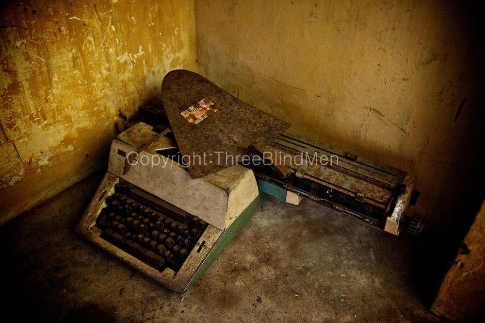 Discarded typewriter and garden shovel. Jaffna homes. 2011