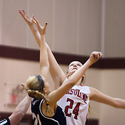 12/27/11 Wilmington DE: Ursuline Academy Jillion Lyons #24 (Right) and Council Rock Emily Grundman #21 jump for the ball during a Diamond State Classic game Tuesday Dec. 27, 2011 at St. Elizabeth High School High School in Wilmington Delaware...Special to The News Journal/SAQUAN STIMPSON