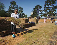 Volunteer Ramsey Frey lays sod at Rivers Hill Park in Oxford, Miss. on Monday, April 22, 2013. Volunteers also installed playground mulch.