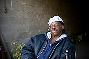 A man sits drinking in an open garage close to the Eastern Market, one of the few lively places left in Detroit.<br />  Detroit, craddle of the American car industry has officially filed for bankruptcy. USA Since the economic crisis 2/3rd of it's population has left the city and turned it into a ghost town.