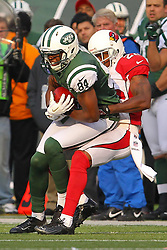 Dec 2, 2012; East Rutherford, NJ, USA; New York Jets wide receiver Stephen Hill (84) catches a pass while being defended by Arizona Cardinals cornerback William Gay (22) during the first half at MetLIfe Stadium.