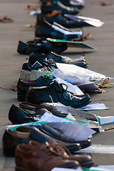 London, December 10th 2014. The shoes of hundreds of victims who died in Ireland, North and South during the Troubles are lined up opposite Downing Street as families demand that a proper investigation into over 3,600 deaths and 40,000 injuries on all sides, sets the truth free. PICTURED: The shoes of victims of violence, a poignant reminder of lives long lost.